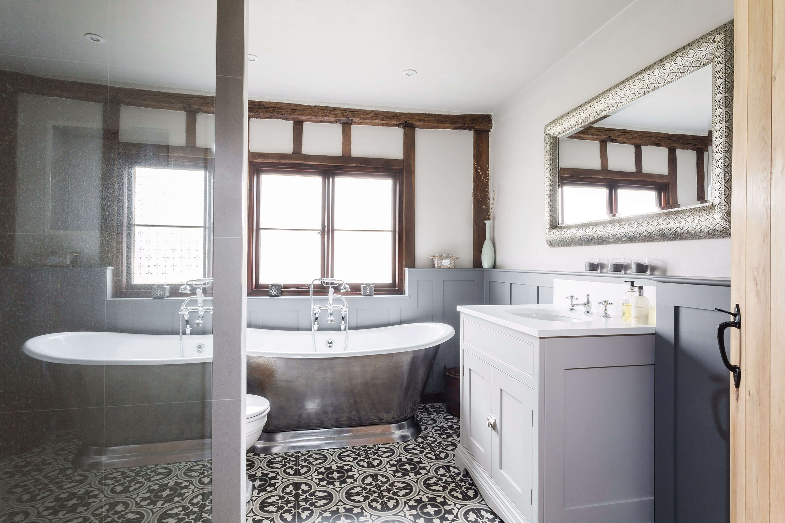 a contemporary family bathroom with traditional style