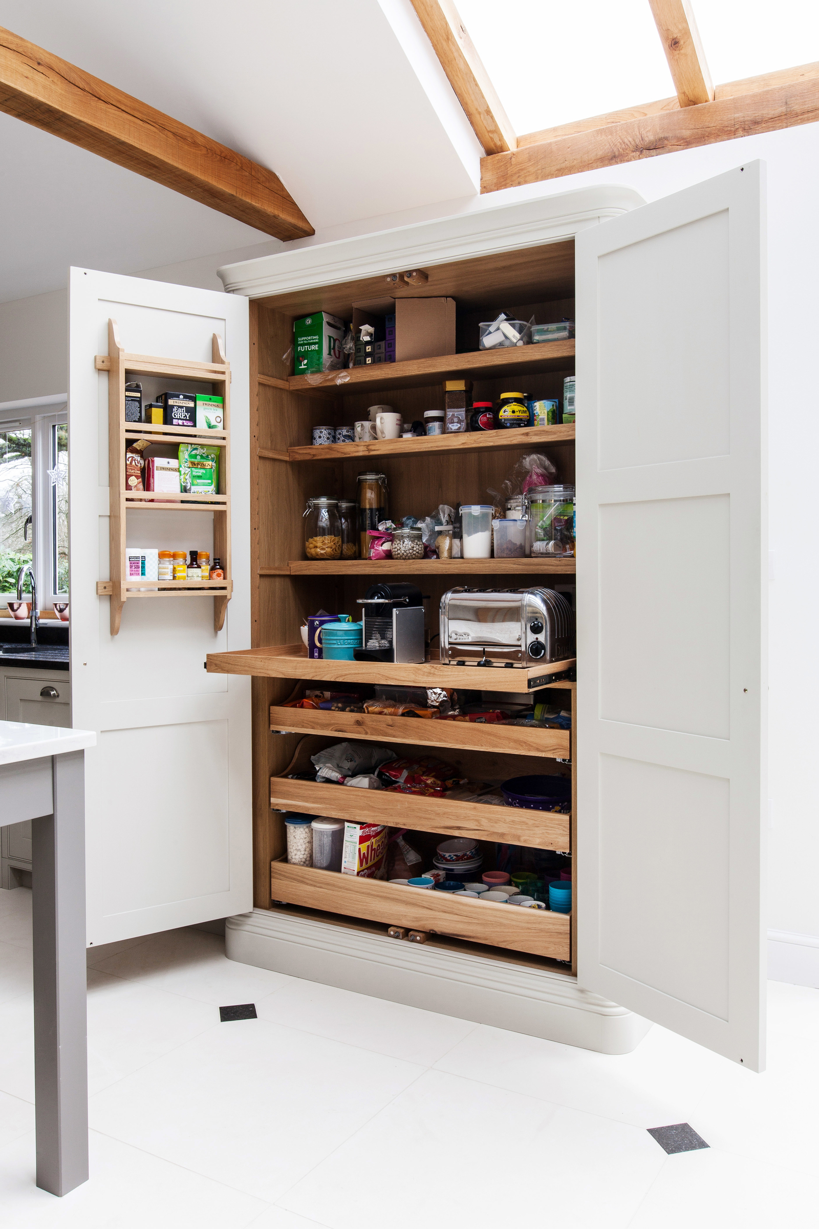 A breakfast cupboard with pull out drawers made by burlanes interiors