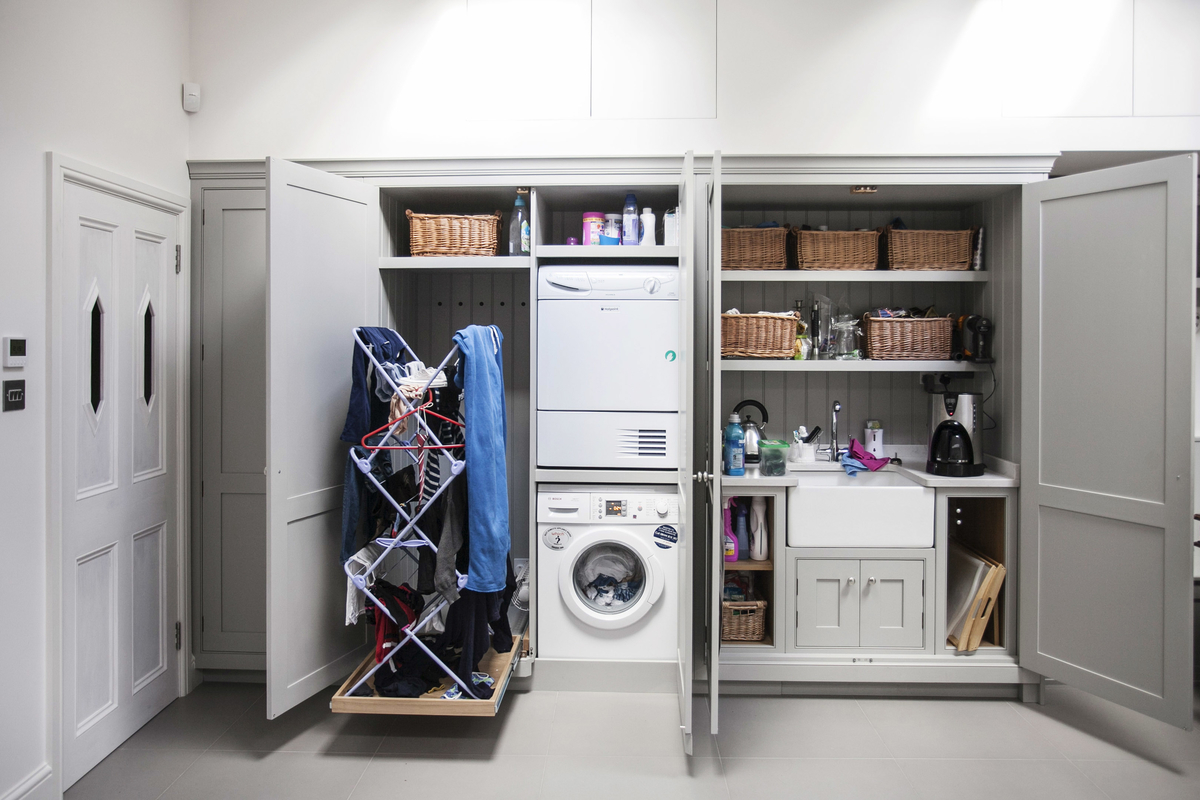A hidden Utility cupboard made by burlanes interiors