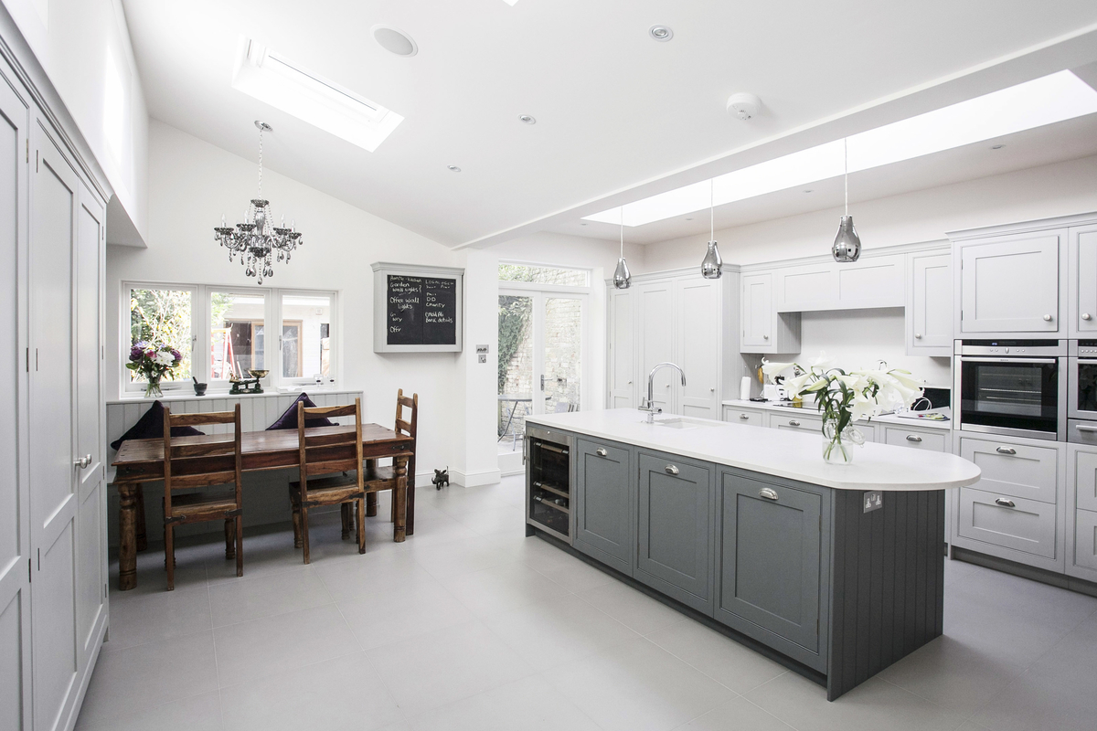 Burlanes kitchen with banquette seating facing kitchen island.jpg