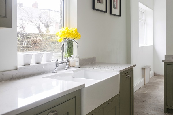 The Cosentino granite worktop is cut to fit the double belfast sink ...