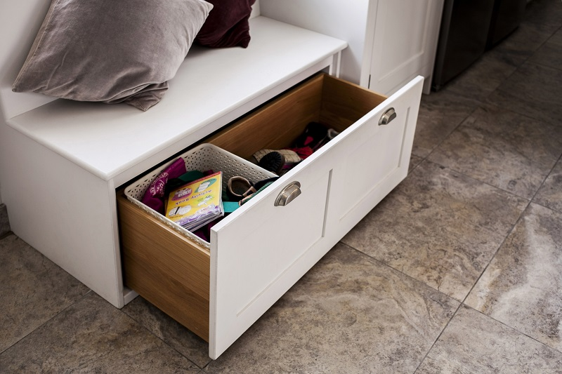 Custom built storage drawer in the banquette seating