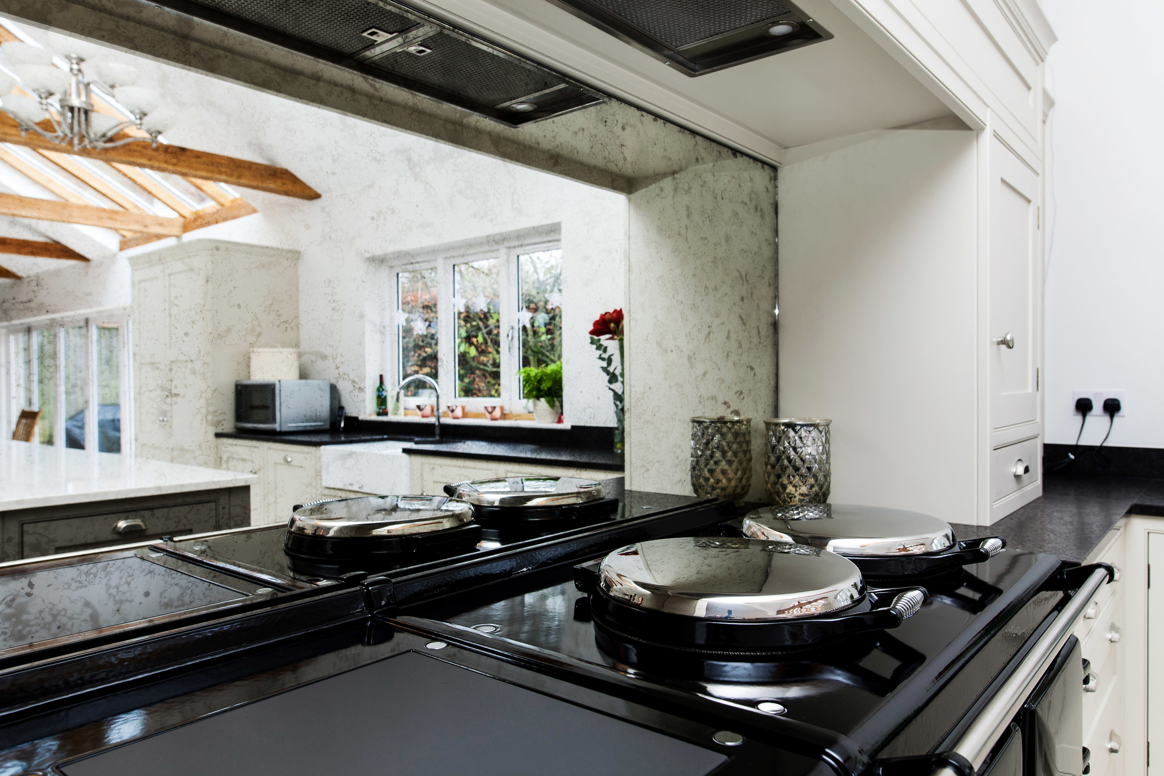 an antique mirrored glass splashback