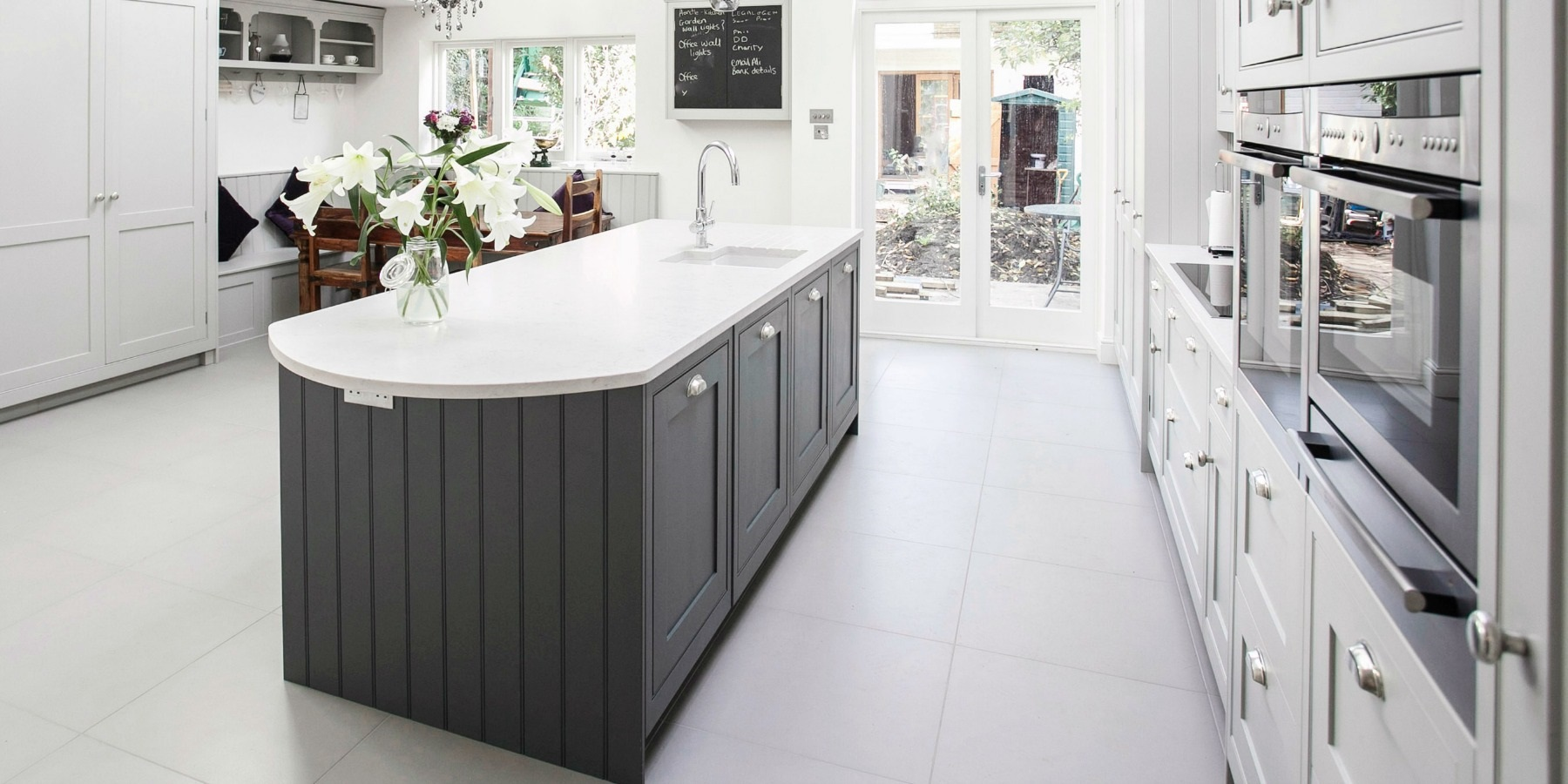 Luxury Bespoke Shaker Kitchen - Burlanes grey handmade Wellsdown kitchen with central island and shaker style panelling.