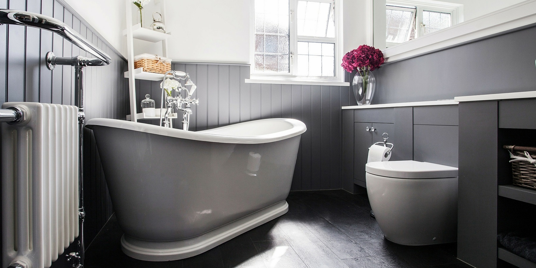 Bespoke Hotel Style Bathroom Design - Burlanes handmade boutique bathroom furniture with beautiful roll top freestanding bath and shaker wall panelling.