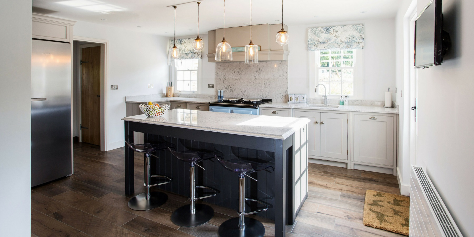 Bespoke Cottage Style Shaker Kitchen - Burlanes handmade Wellsdown kitchen with classic AGA range, central island and beautiful pendant lighting.