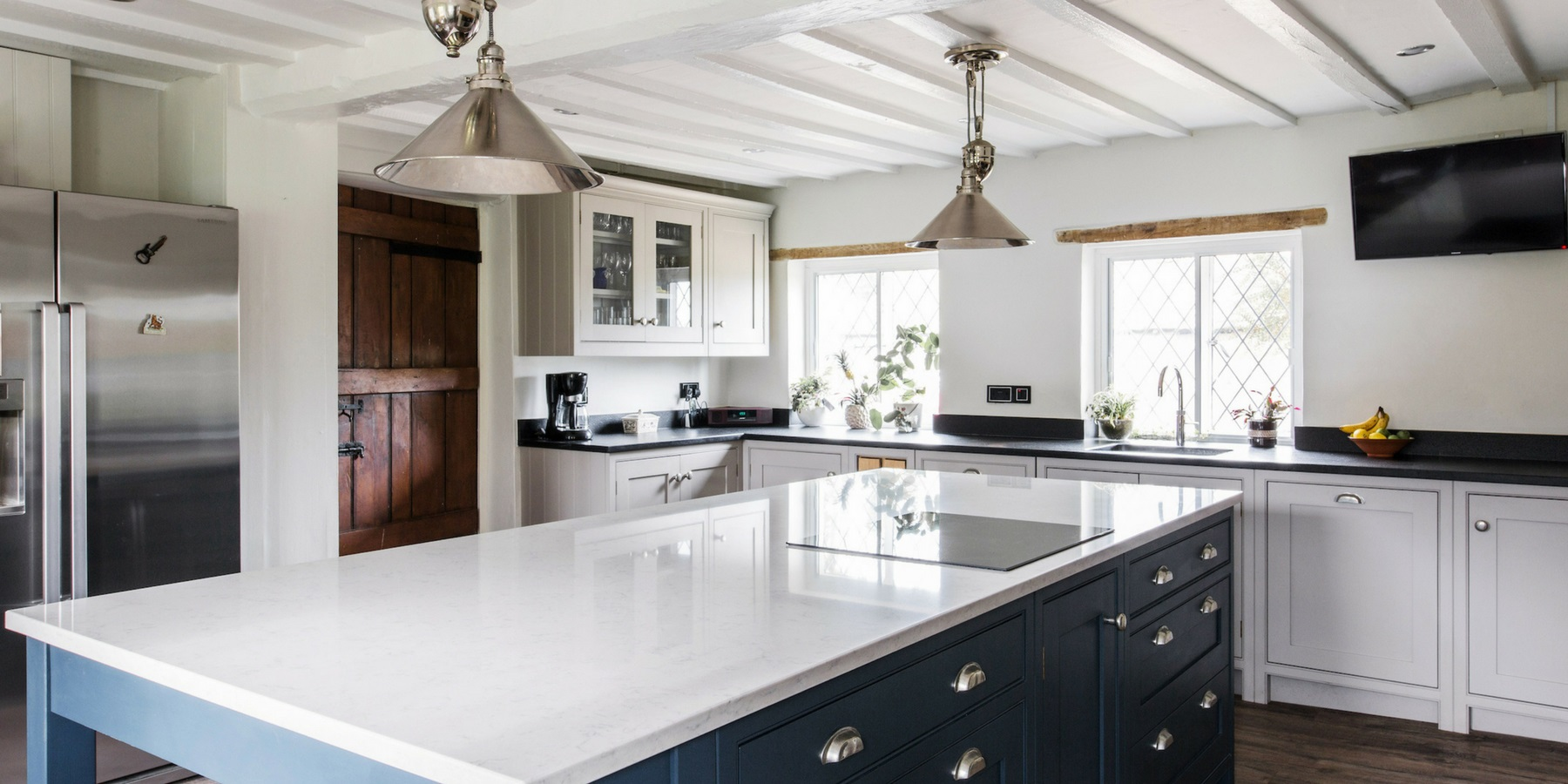 Bespoke Cottage Style Shaker Kitchen - Burlanes luxury country cottage style Wellsdown kitchen with white worktops and induction hob.