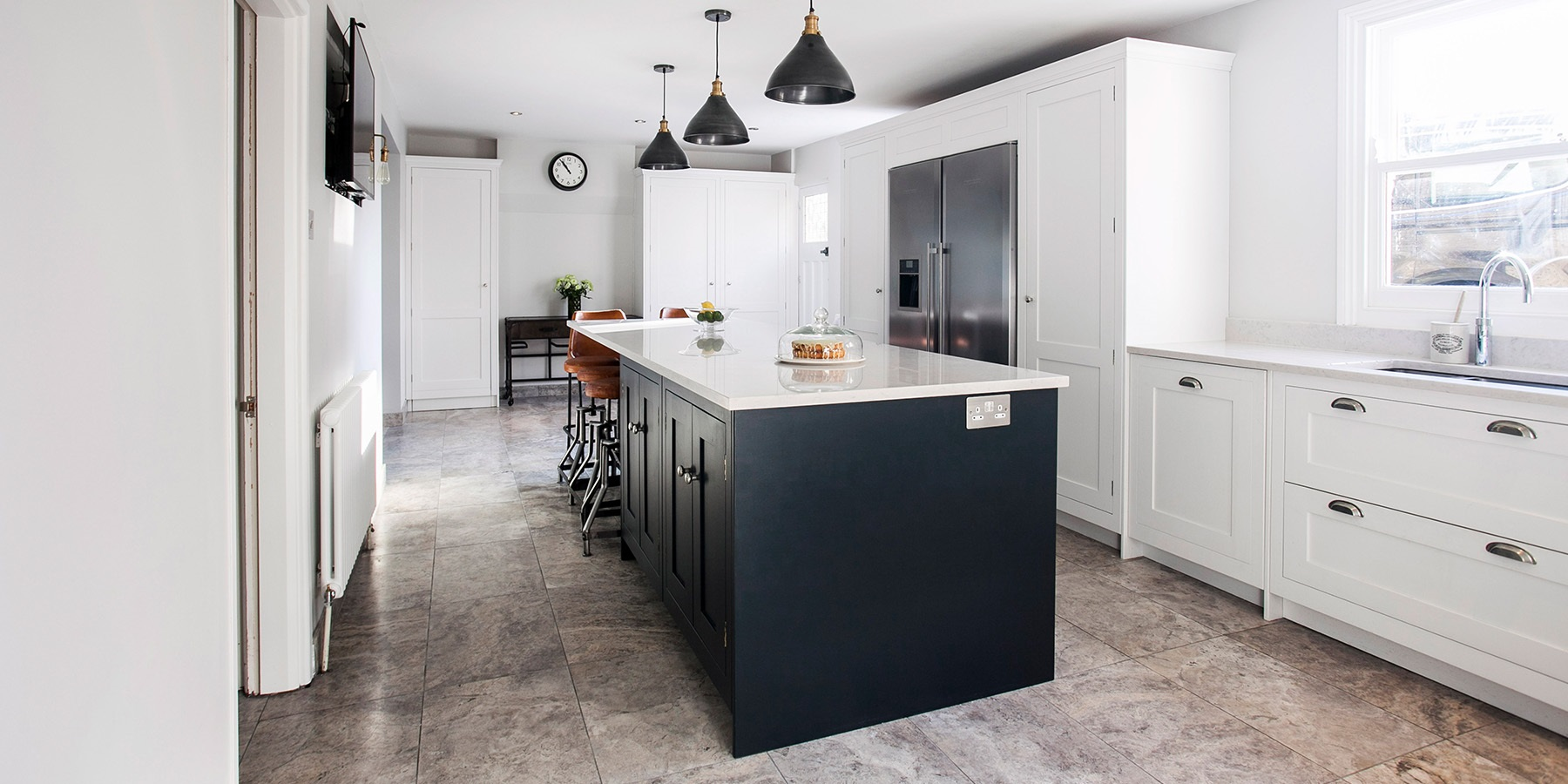 handmade Family Kitchen - Burlanes classic Hoyden kitchen in white and navy, with white worktops and large stainless steel fridge.
