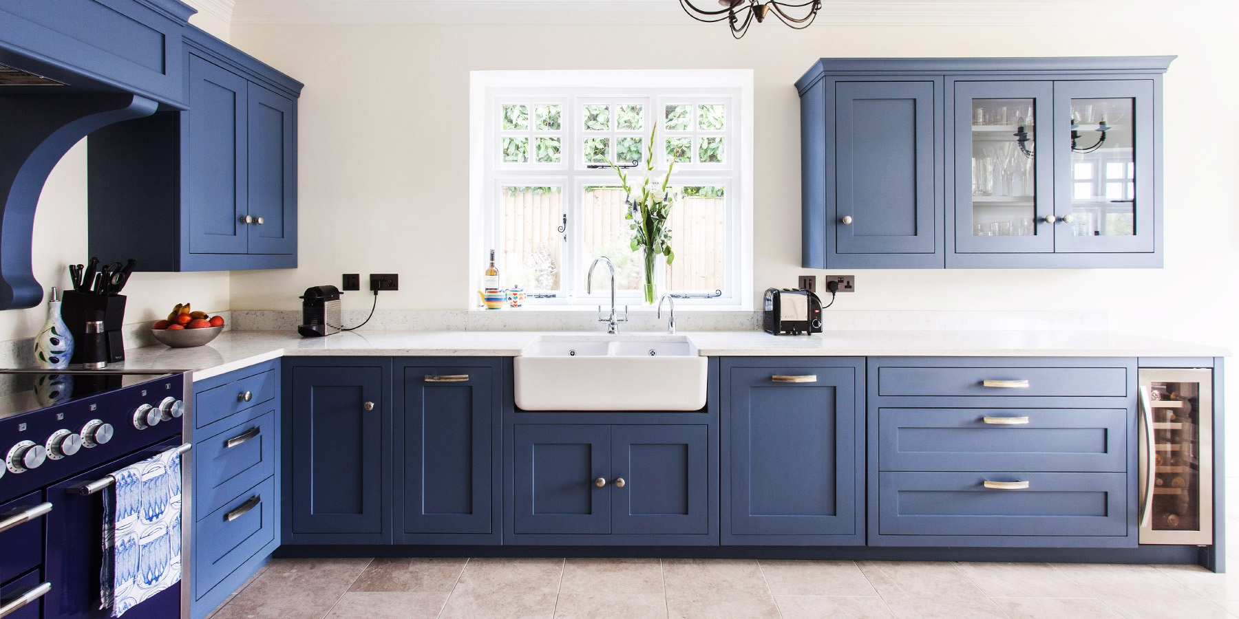 Classic Handmade Colourful Shaker Kitchen - Burlanes bespoke Hoyden kitchen in Royal Blue with white worktop and belfast sink.