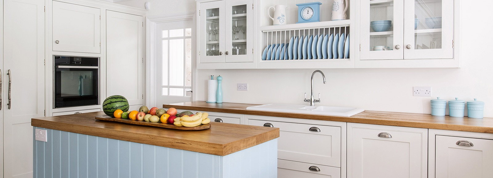 Bespoke Coastal Shaker Kitchen - Burlanes bespoke handmade Wellsdown kitchen, handpainted in white and blue, with central island and shaker panelling.