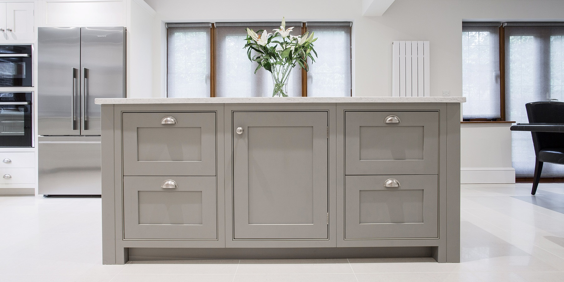 Burlanes Bespoke Kitchen Island - Handmade freestanding kitchen island with white worktops and antique silver cup handles.