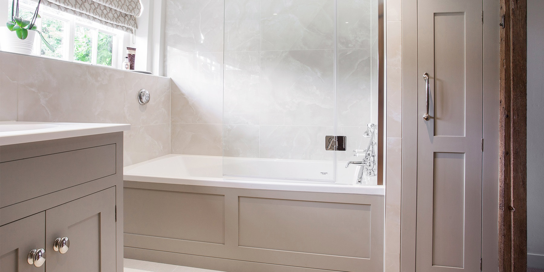 Luxury Bespoke Family Bathroom - Burlanes handmade bathroom furniture with boxed in bath and storage solutions.