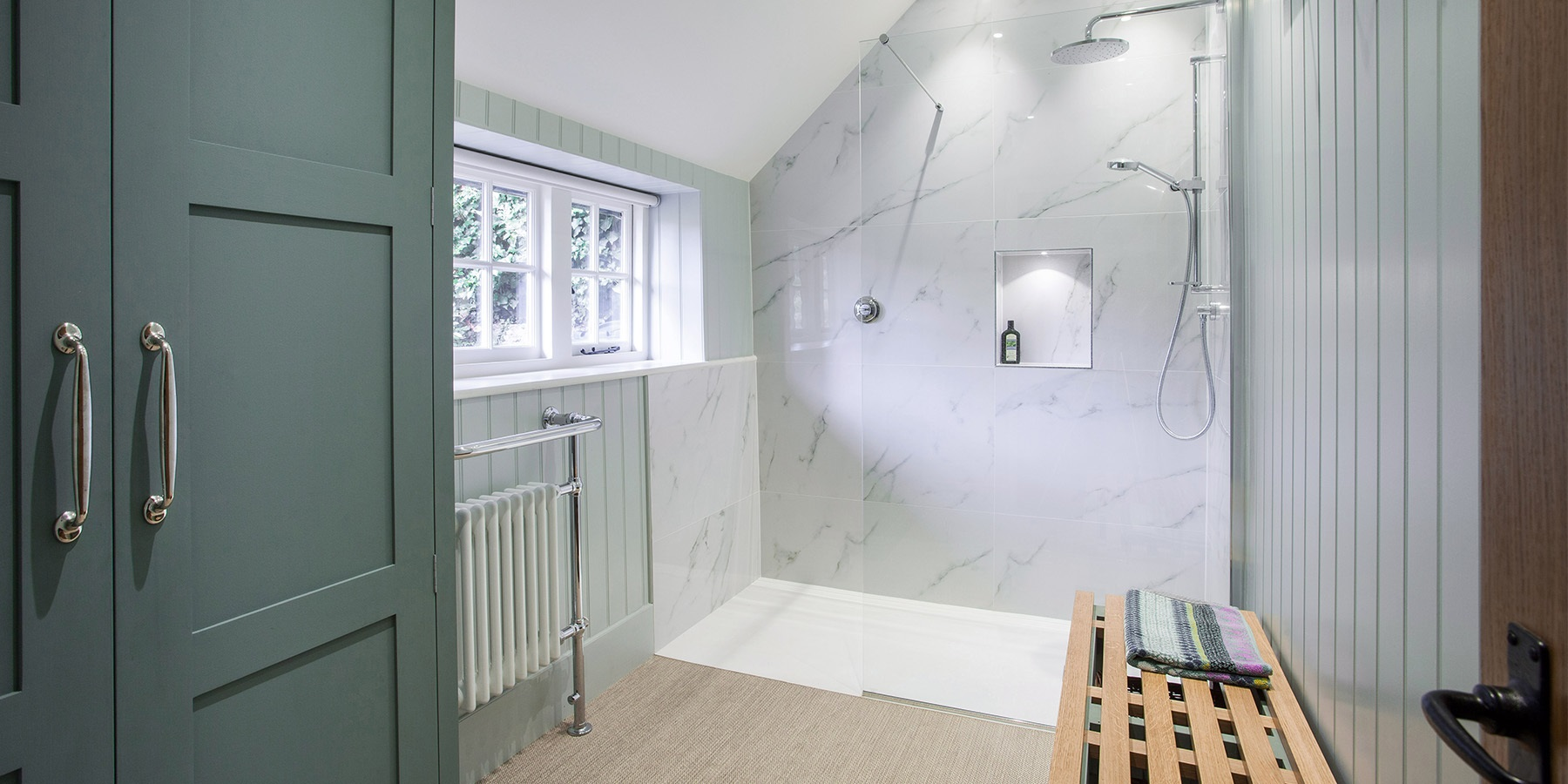 Bespoke Luxury Shower Room - Burlanes handmade bathroom furniture with walk-in shower area and marble tiles.