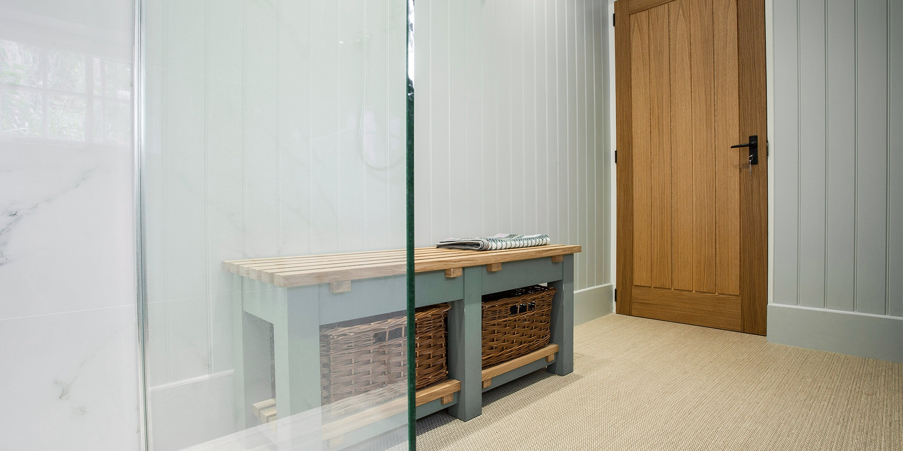 Bespoke Wet Room Design - Burlanes walk-in wet room and shower area with handmade bench seating.