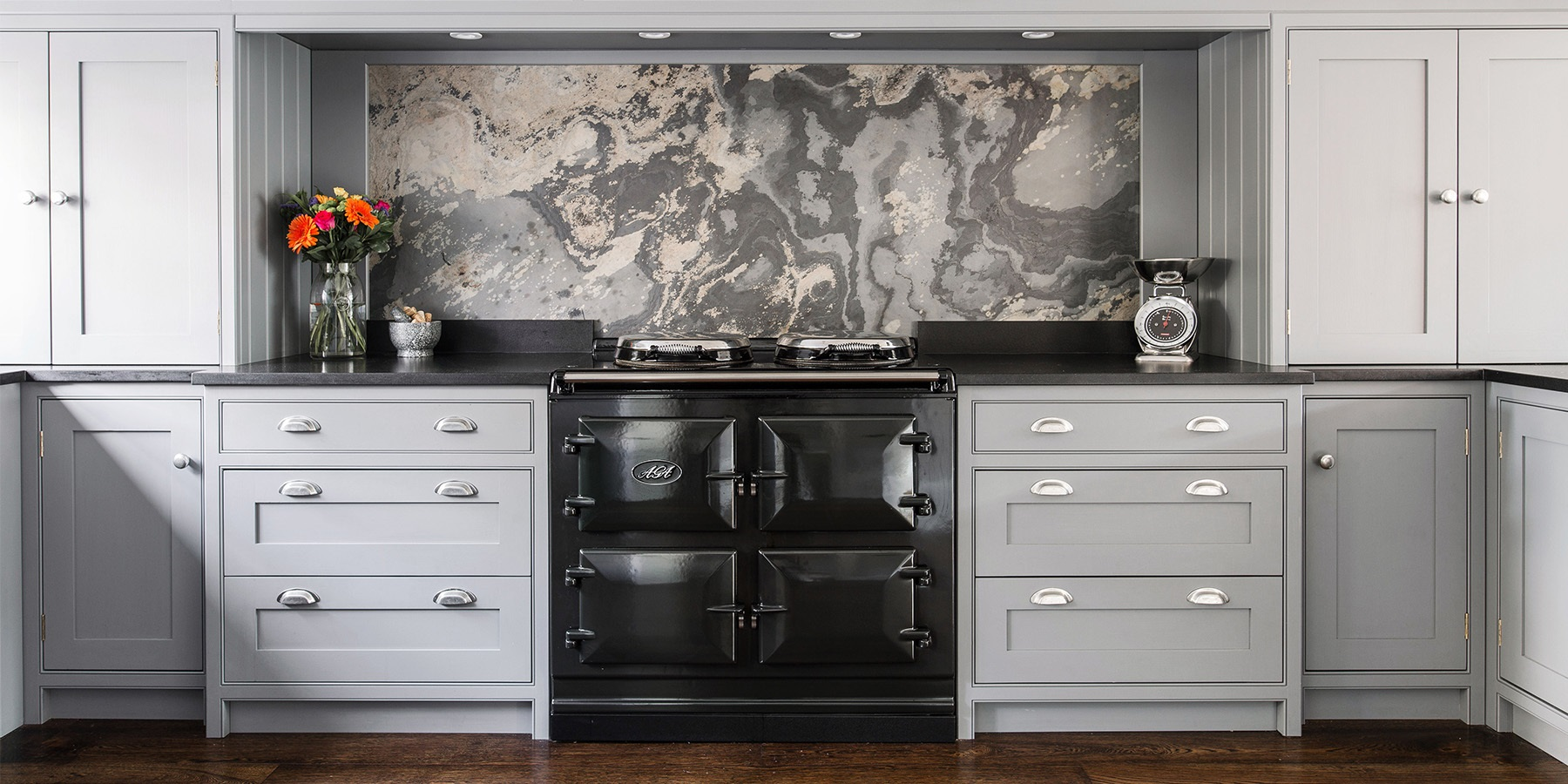 Luxurious Shaker Kitchen With Marble Splashback & AGA - Handmade Wellsdown shaker kitchen in grey, with beautiful marble splashback and classic AGA Total Control.