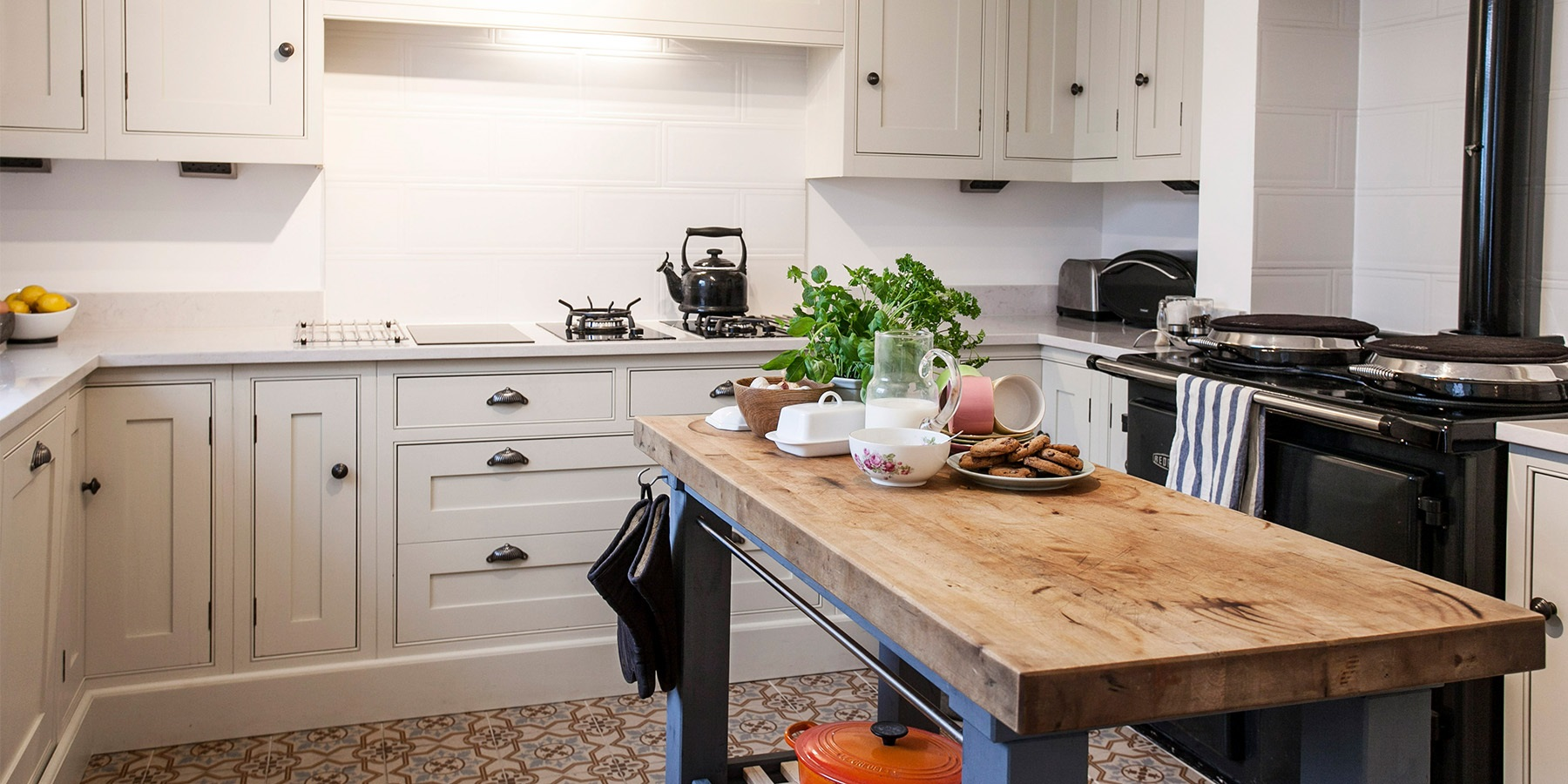 Bespoke White Shaker Kitchen With AGA Total Control - Handmade Wellsdown kitchen cabinetry with beautiful white worktops, and AGA Total Control in Black.
