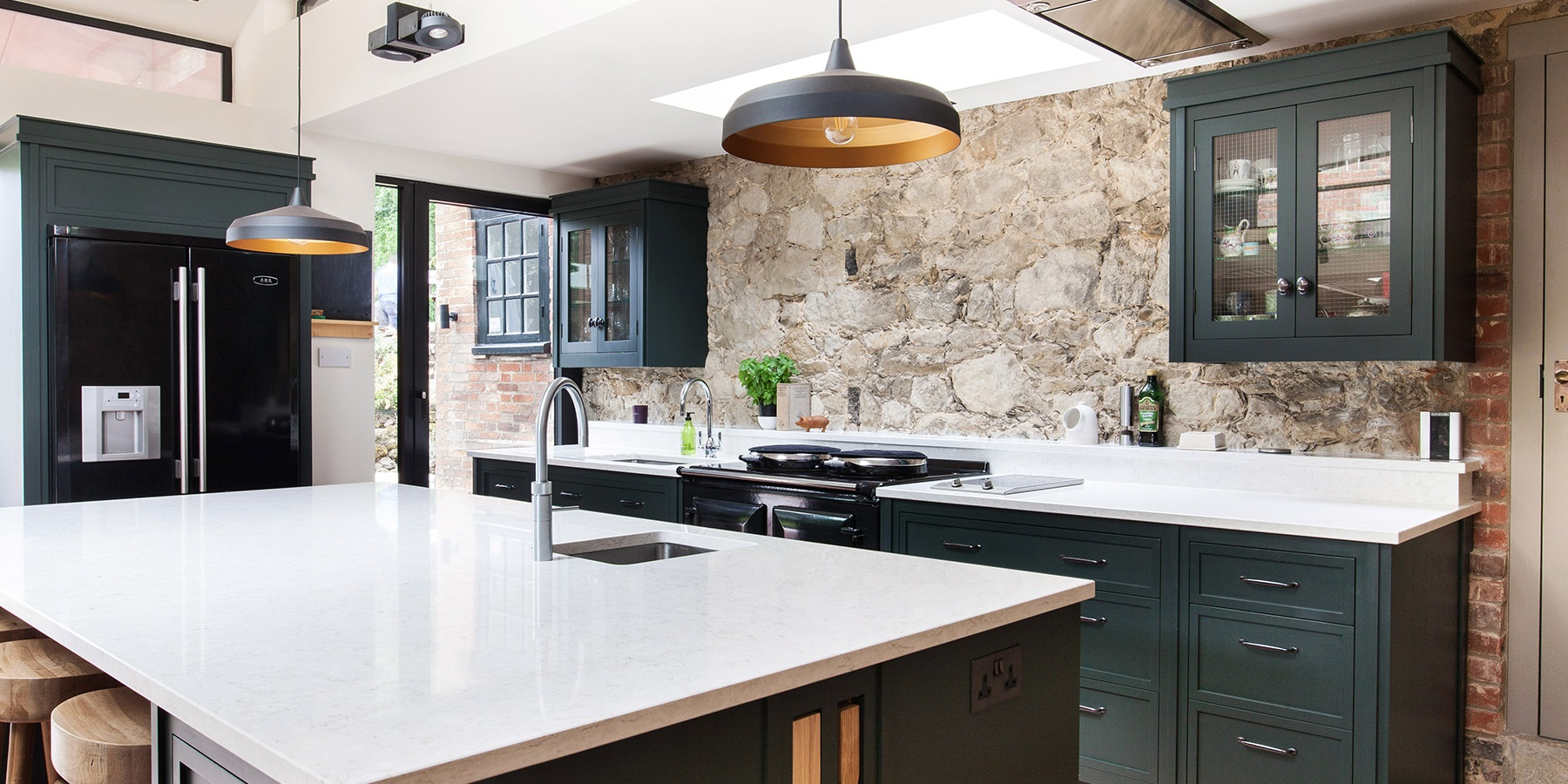 Bespoke Oast House Shaker Kitchen - Burlanes handmade Decolane kitchen island with white worktops, prep sink and Quooker boiling water tap.