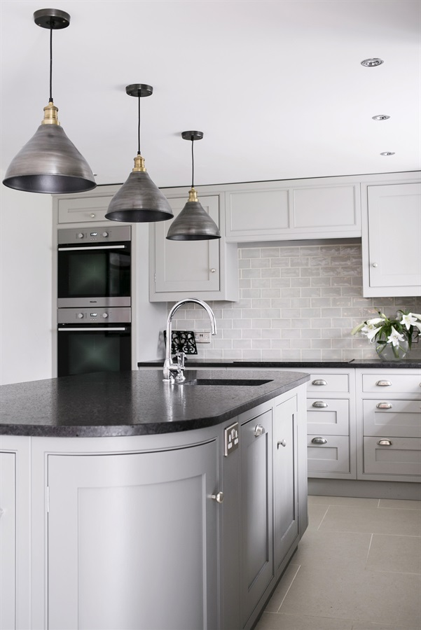 Bespoke Luxury Kitchen Design - Burlanes handmade grey Wellsdown cabinetry with central kitchen island, black worktops and pendant lights.