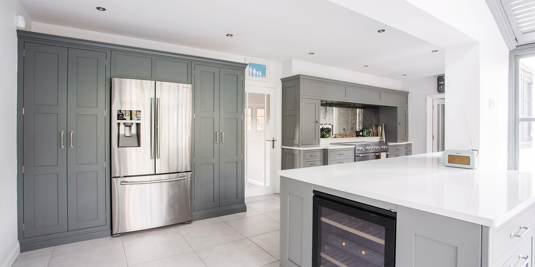 Luxury Open Plan Family Kitchen - Burlanes classic Hoyden kitchen with beautiful big larder units and kitchen island, perfect for entertaining.