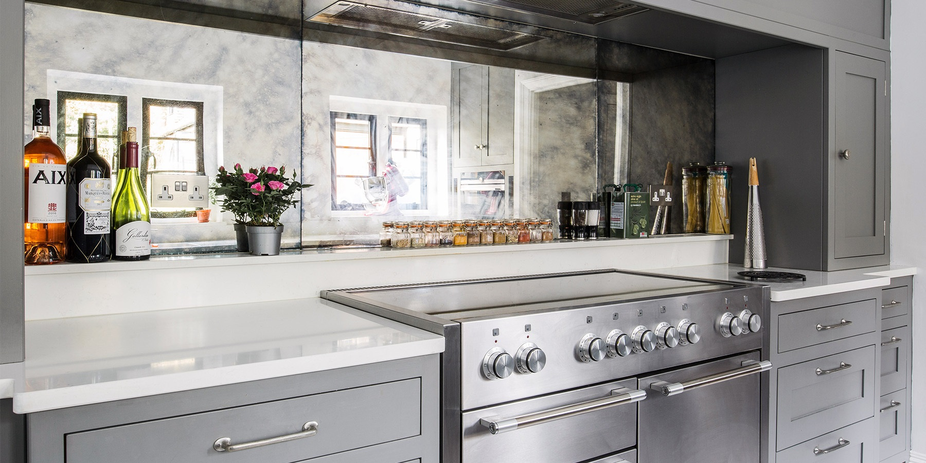Luxury, Bespoke Kitchen - Burlanes handmade Hoyden oven surround with mirrored splashback tiles.