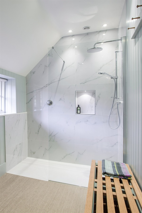 Designer Walk-in Shower Room - Burlanes walk-in shower room with bespoke shower screen and marble tiles.
