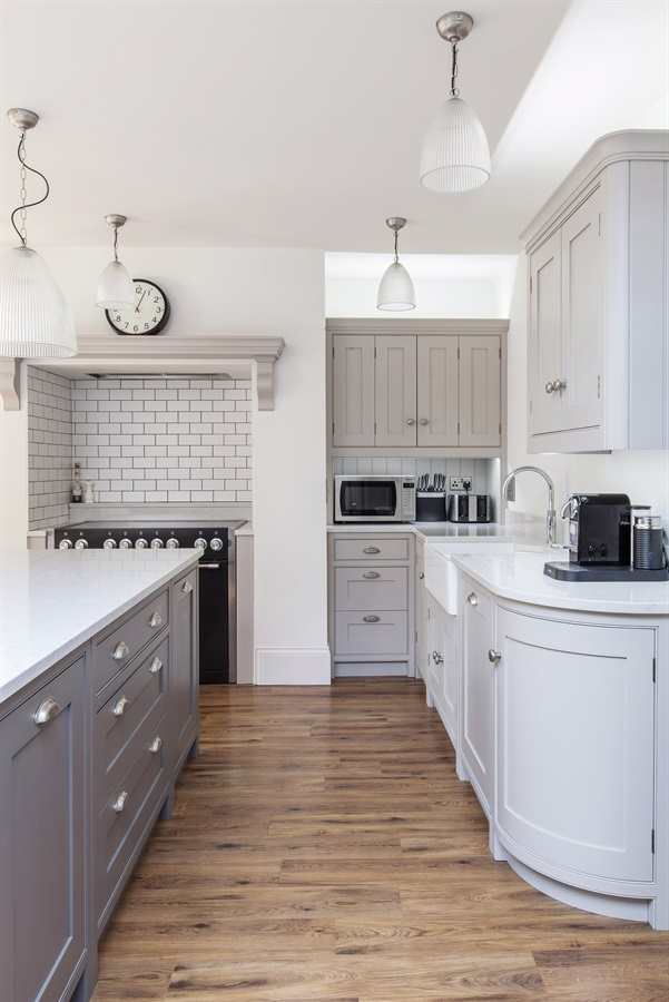 Bespoke Grey Shaker Kitchen - Burlanes handmade Wellsdown kitchen with curved cabinets and white worktops.