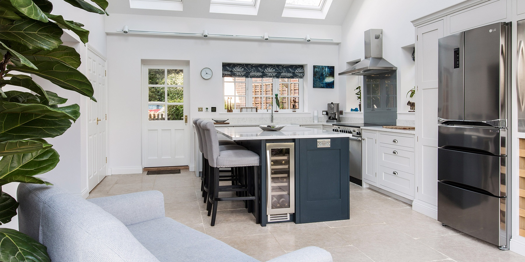 Bespoke Luxury Handmade Kitchen - Burlanes bespoke Hoyden kitchen perfect for entertaining guests, with central kitchen island and wine coolers.