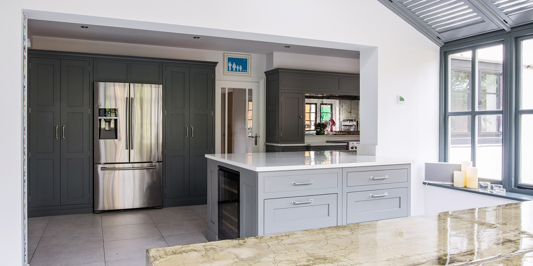 Bespoke Modern Kitchen  - Burlanes handmade Hoyden kitchen, with large larder units, white worktops and kitchen island.