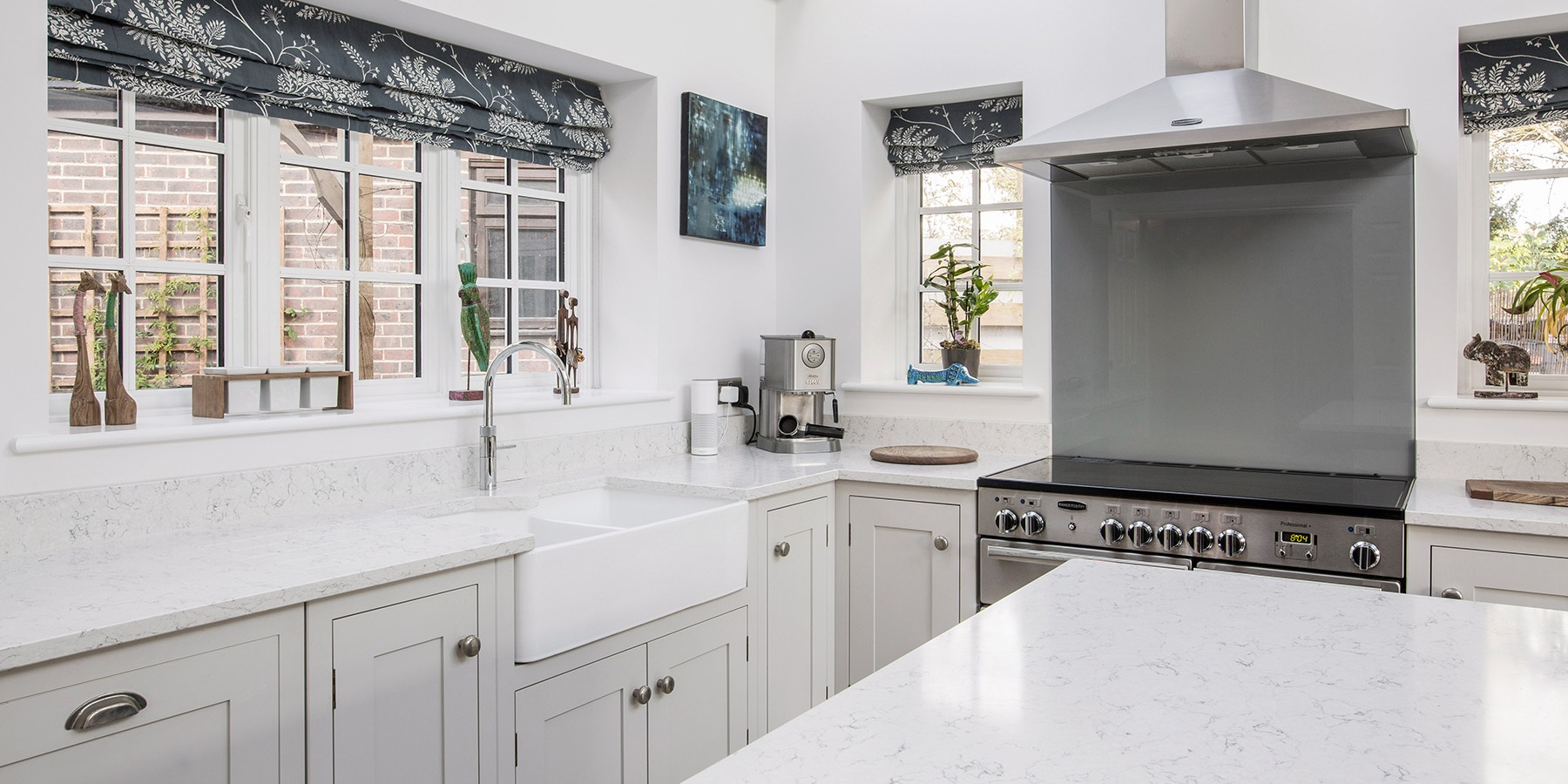 Handmade Shaker Kitchen - Burlanes classic Hoyden kitchen in white with white worktops, belfast sink and Quooker boiling water tap.