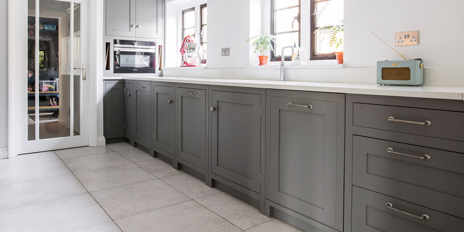 Classic Handmade Galley Kitchen - Burlanes Hoyden galley kitchen in grey with white worktops and silver handles.