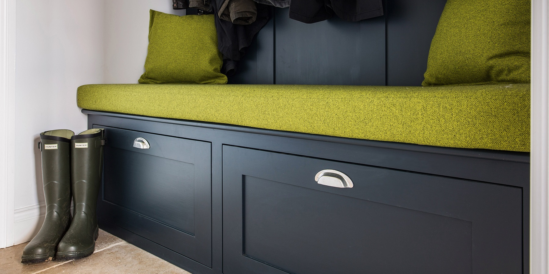 Burlanes Bespoke Bootroom - Handmade bootroom banquette seating with shaker panelling and coat hooks.