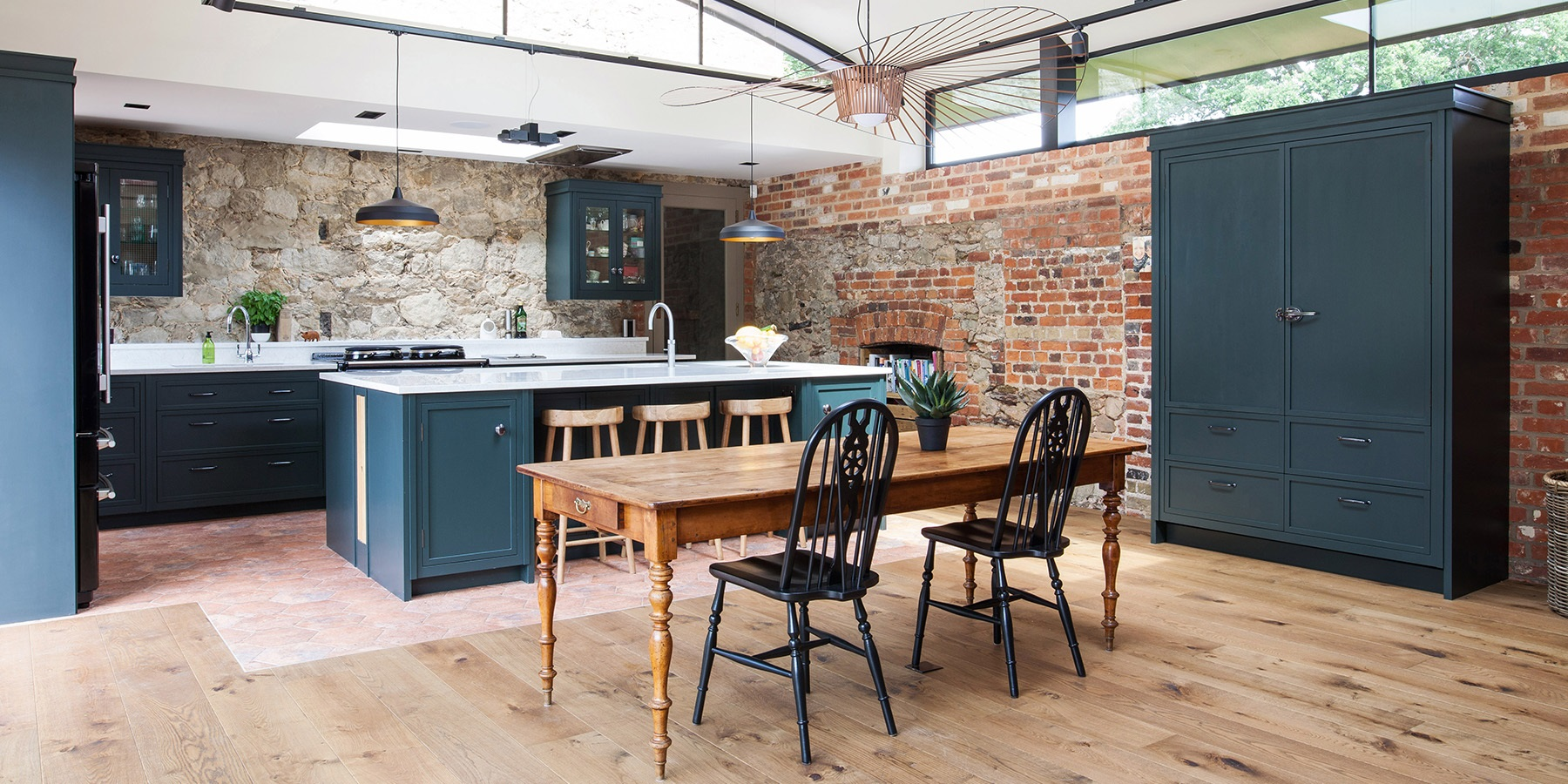 Bespoke Oast House Shaker Kitchen - Burlanes handmade Decolane kitchen with central kitchen island, freestanding larder and classic AGA Total Control.