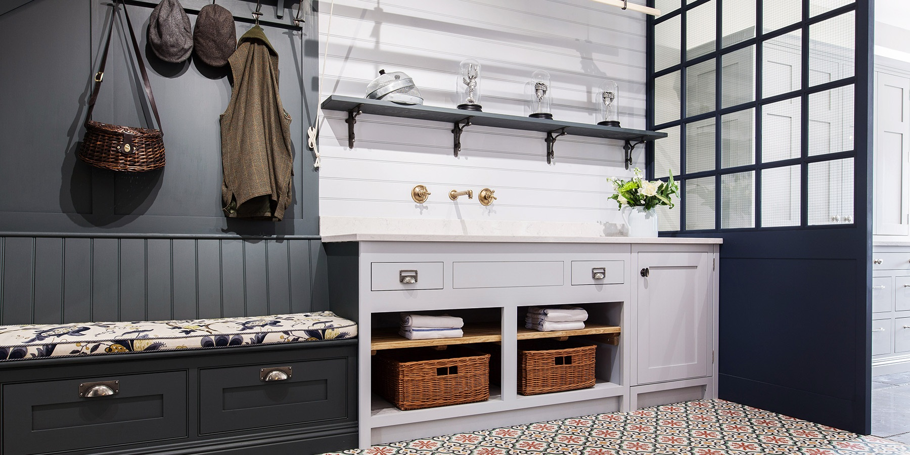 Bespoke Utility & Bootroom - Burlanes handmade utility room furniture with storage, handmade banquette seating with drawers and shaker style wall panelling with coat hooks.