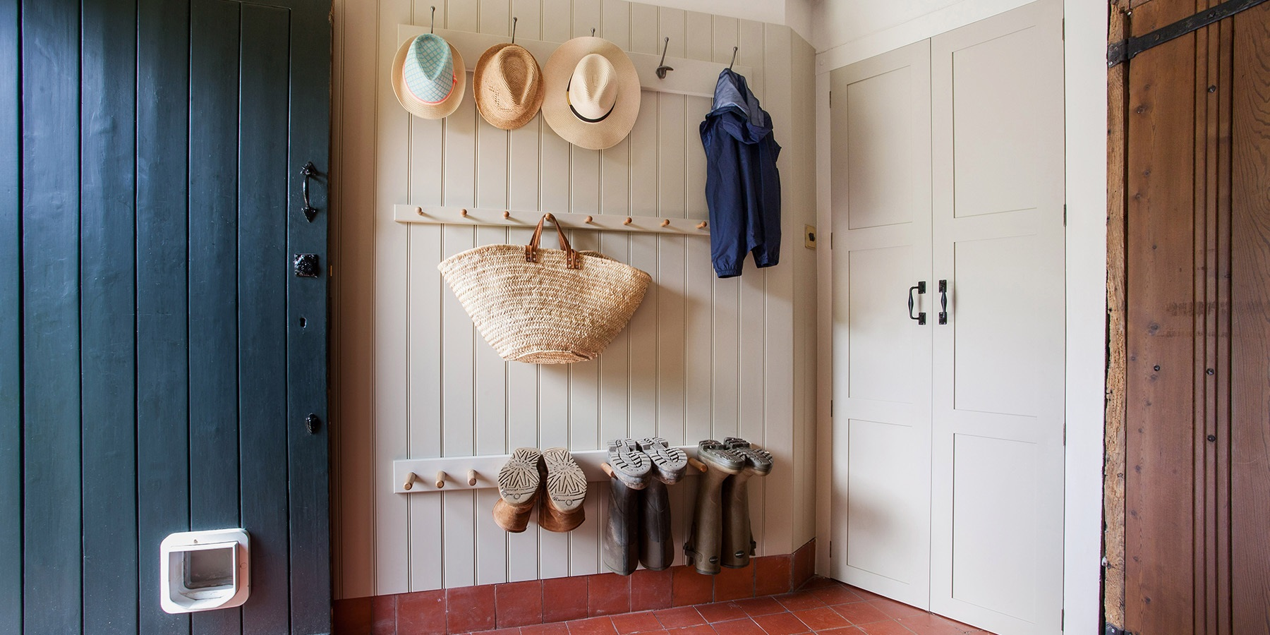 Bespoke Oast House Bootroom - Burlanes handmade shaker style wall panelling with coat hooks.
