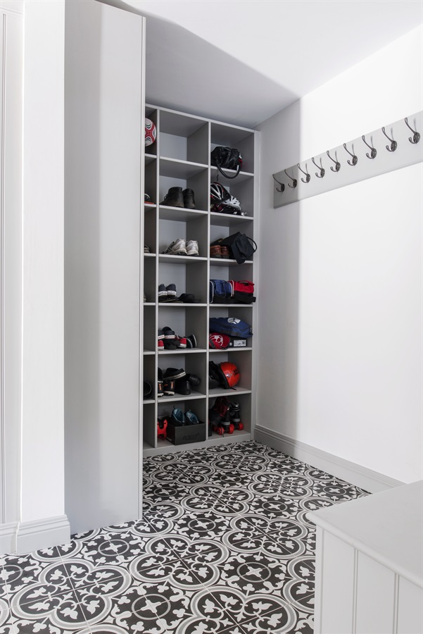 Bespoke Bootroom Design - Burlanes handmade bootroom banquette seating, custom made storage solutions and Ca'Pietra encaustic floor tiles.