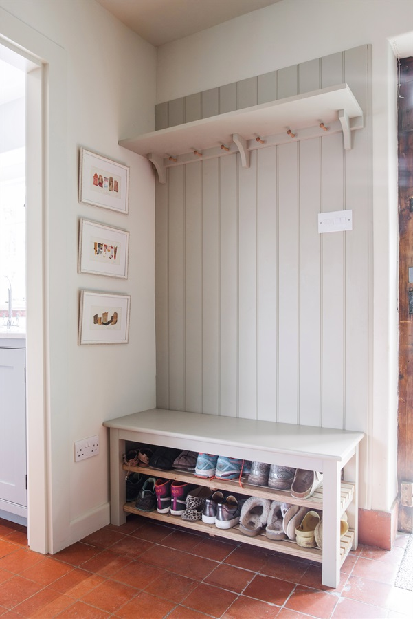 Bespoke Bootroom Storage Solutions - Burlanes handmade bench seating with shoe storage, shaker style wall panelling and coat hooks.
