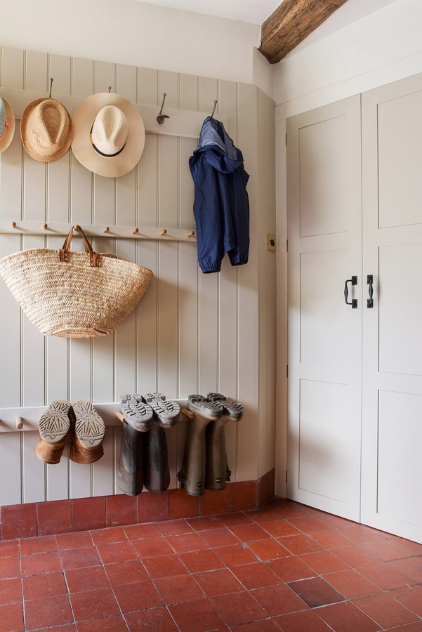 Bespoke Oast House Bootroom - Handmade shaker wall panelling with coat hooks.