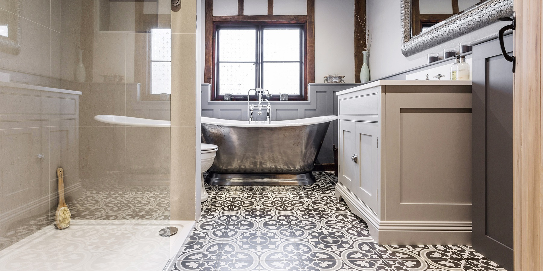 Luxury, Bespoke Family Bathroom - Beautiful family bathroom in an converted barn, with handmade bathroom furniture, cast iron Hurlingham bath and encaustic floor tiles by Ca'Pietra.