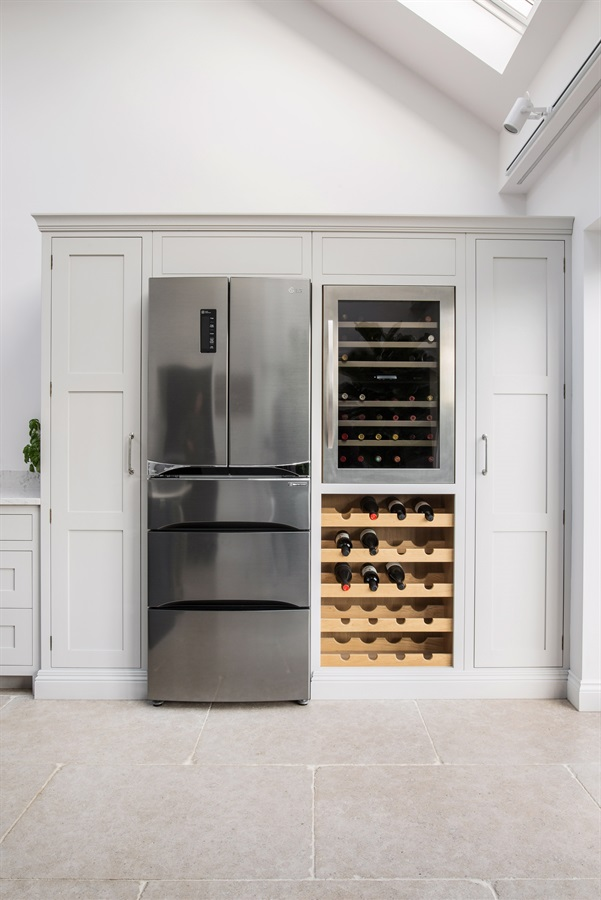 Burlanes Bespoke Kitchen - Handmade Hoyden kitchen with refrigerator surround, integrated wine cooler and handmade wine rack.