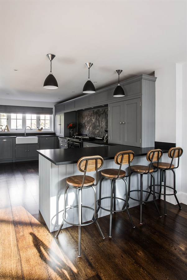Bespoke Luxurious Grey Shaker Kitchen - Handmade shaker kitchen with breakfast bar and black pendant lighting.