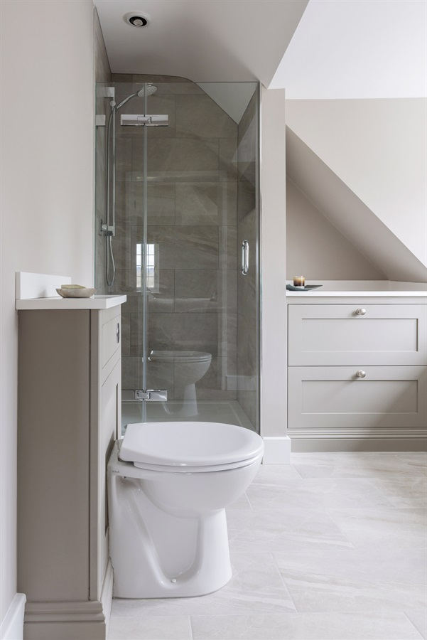 Bespoke Contemporary Bathroom Design - Burlanes handmade bathroom furniture with bespoke walk-in shower area with bi-fold glass door.