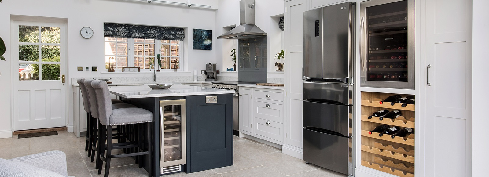 Luxury Shaker Kitchen - Burlanes bespoke Hoyden kitchen with central island, wine cooler and handmade wine rack.