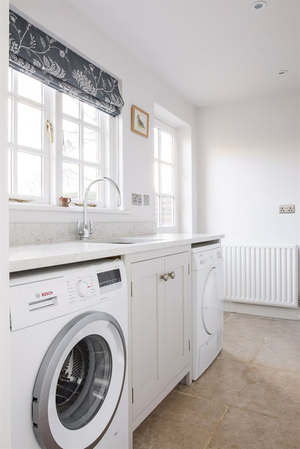 Bespoke Utility Room Furniture - Handmade laundry room furniture with appliances and utility sink.