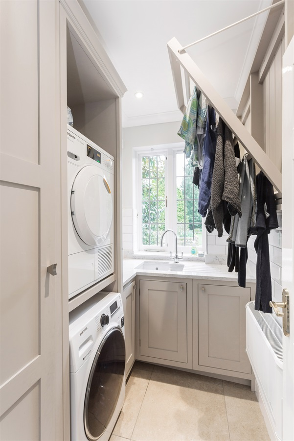 Bespoke Utility Room Furniture - Handmade utility room cabinets with stacked appliances and bespoke Shelia Maid.