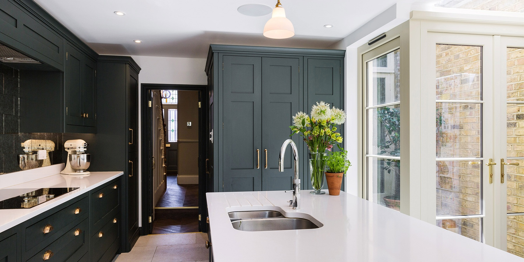 Handmade Town House Shaker Kitchen - Burlanes bespoke Hoyden kitchen cabinetry in Studio Green by Farrow & Ball with copper handles, with central island, Quooker boiling water tap and beautiful bespoke larder unit.