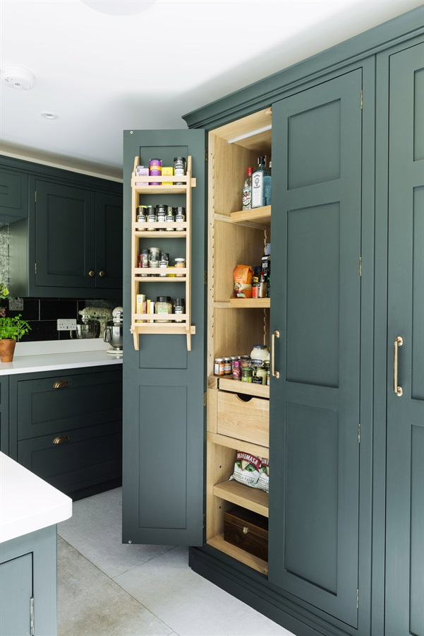 Bespoke Traditional Shaker Kitchen Larder - Handmade kitchen cabinets and tall larder unit, handpainted in Studio Green by Farrow & Ball, with White Quartz worktops and copper handles.