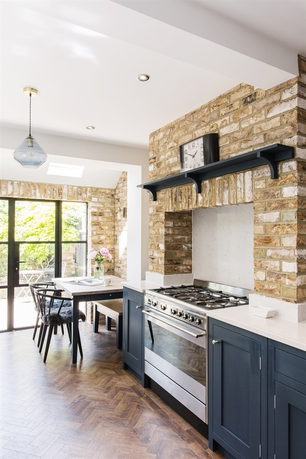 Bespoke Rustic Town House Shaker Kitchen - Burlanes handmade Wellsdown kitchen with white worktops, brick slips and Crittall window style aluminium doors.
