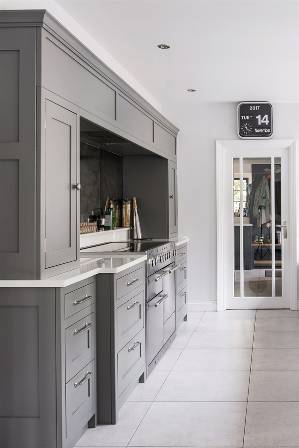 Bespoke, Luxury Oven Surround - Handmade shaker cabinetry with deep pan drawers and white Quartz worktops.