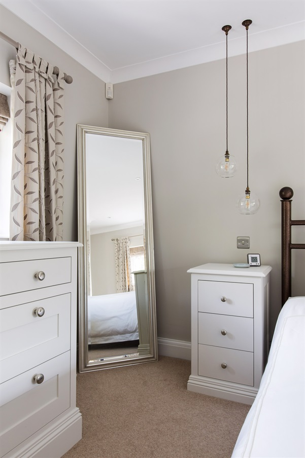 Burlanes Bespoke Bedroom Furniture - Handmade luxury chest of drawers and bedside tables with beautiful pendant lighting.