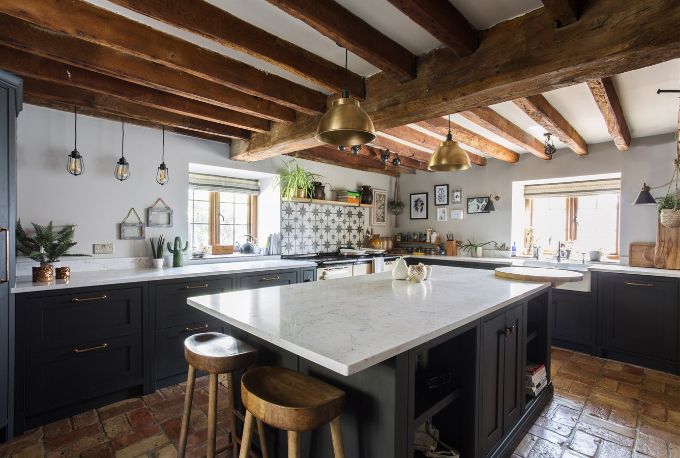Burlanes Bespoke Wellsdown Kitchen - Handmade kitchen painted in 'Artillery Ground' by Mylands, with white worktops and original wooden beams.